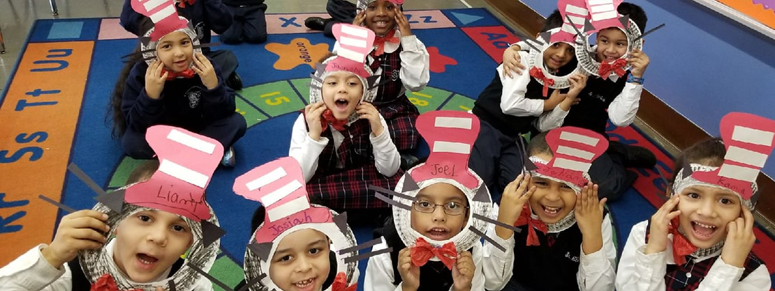 students with paper hats for Seuss Day at St. Elizabeth Catholic Academy