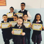 students of the month with certificates at St Elizabeth CA