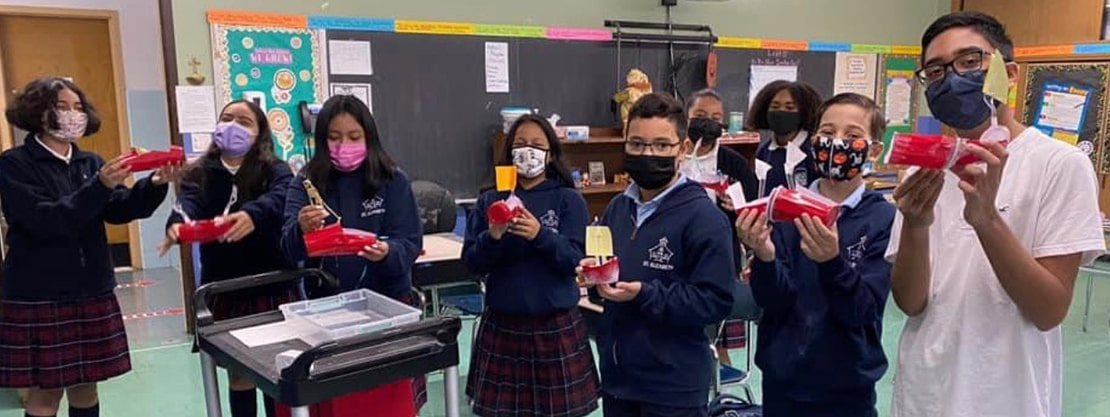 students wearing masks and displaying projects