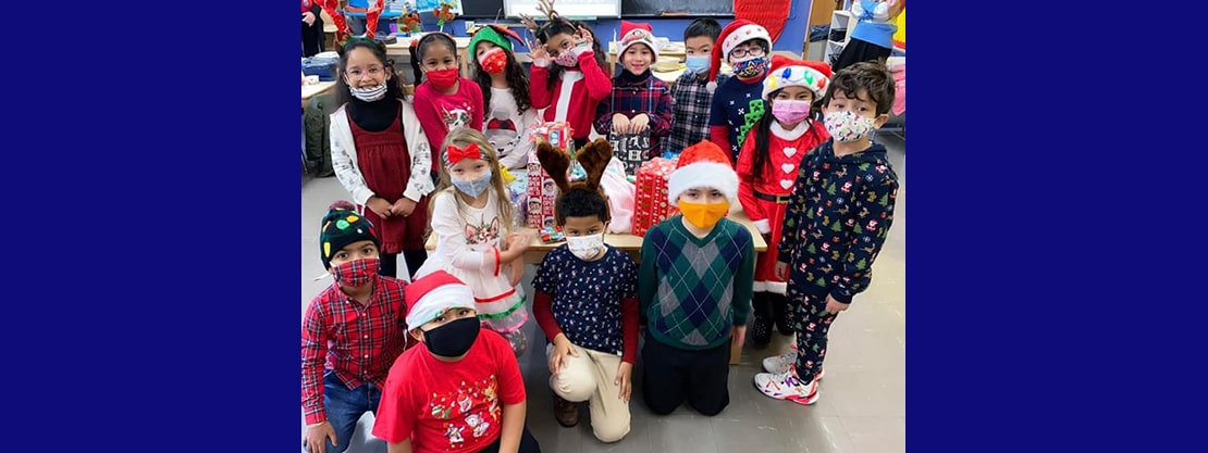 students in christmas clothes and pajamas